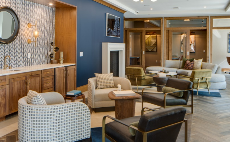 Lounge Area with seating nooks, a fire place, conference room, and co-working suites