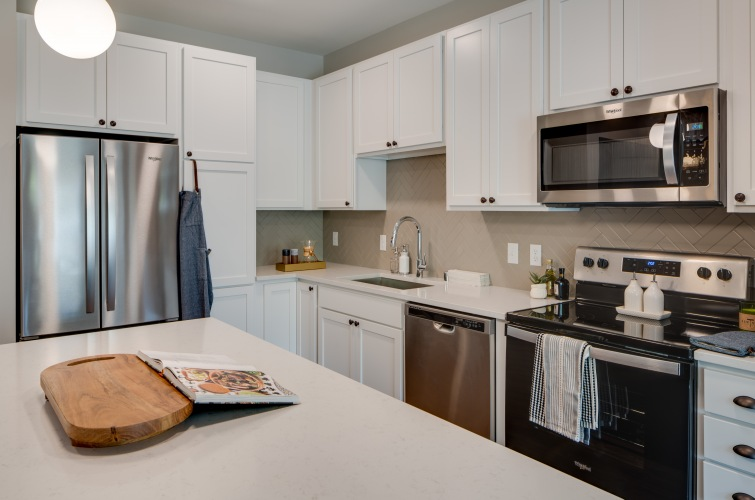Elan West End kitchen with white cabinets and stainless appliances