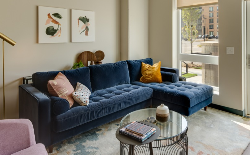 Elan West End living room with blue couch