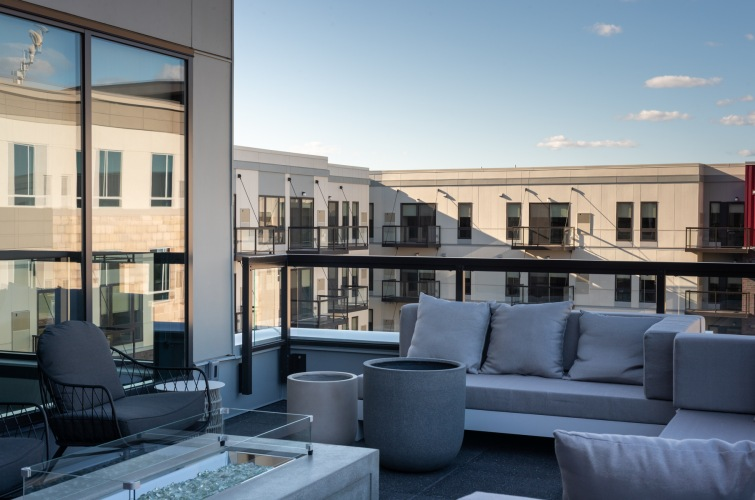Sky Lounge with fire pit overlooking pool courtyard