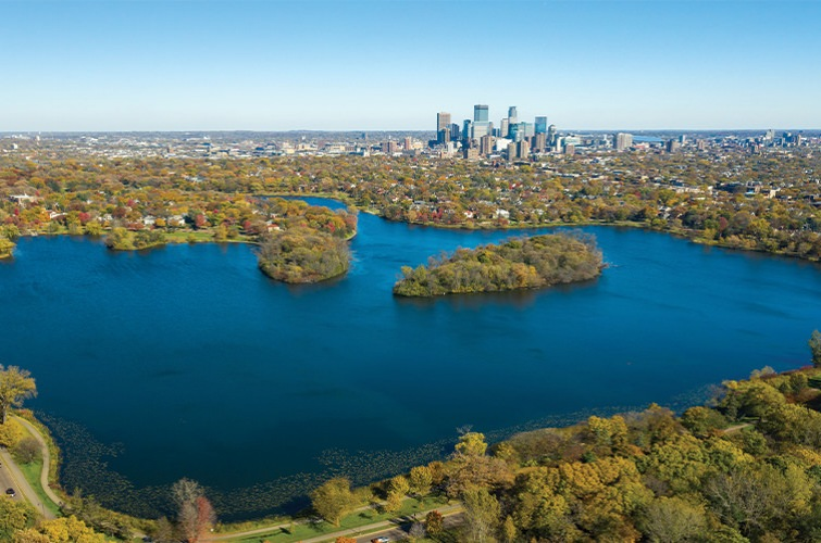 Ariel view of a lake and downtown St Louis Park, MN